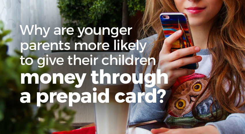 Younger parents giving children money on prepaid card
